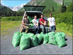 Bags of invasive plants, pulled by Homer District volunteers.